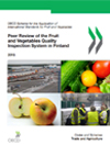 This image is the cover page of the OECD peer review of the fruit and vegetables quality inspection system of Finland. The copyright belongs to OECD. The image consists of four photos: a harbour, where import controls are made; the peer-review team discussing with inspectors, some vegetables including cucumber, tomatoes and salad; and apples.